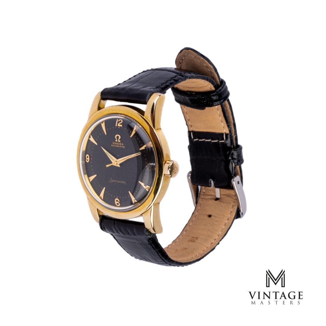 vintage Omega Seamaster watch. Honeycomb Black dial Gold/Steel ref: 2577 – 17 SC side