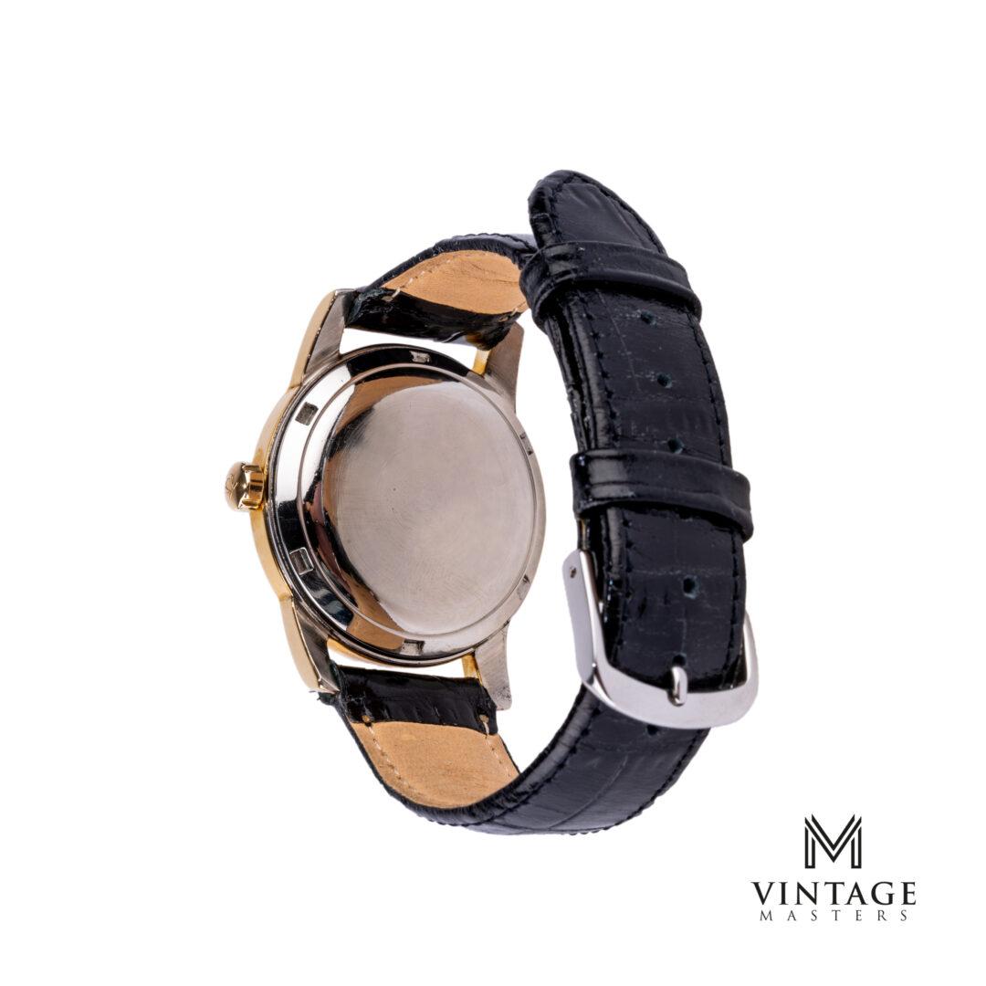 vintage Omega Seamaster watch. Honeycomb Black dial Gold/Steel ref: 2577 – 17 SC caseback