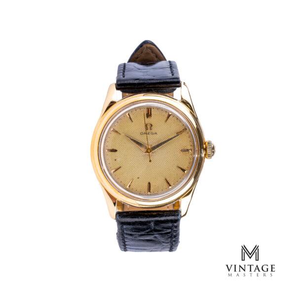 vintage Omega 18k gold 2690 honeycomb dial watch front