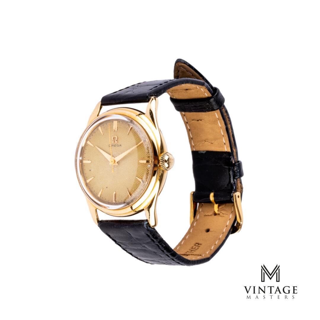 vintage Omega 18k gold 2690 honeycomb dial watch side