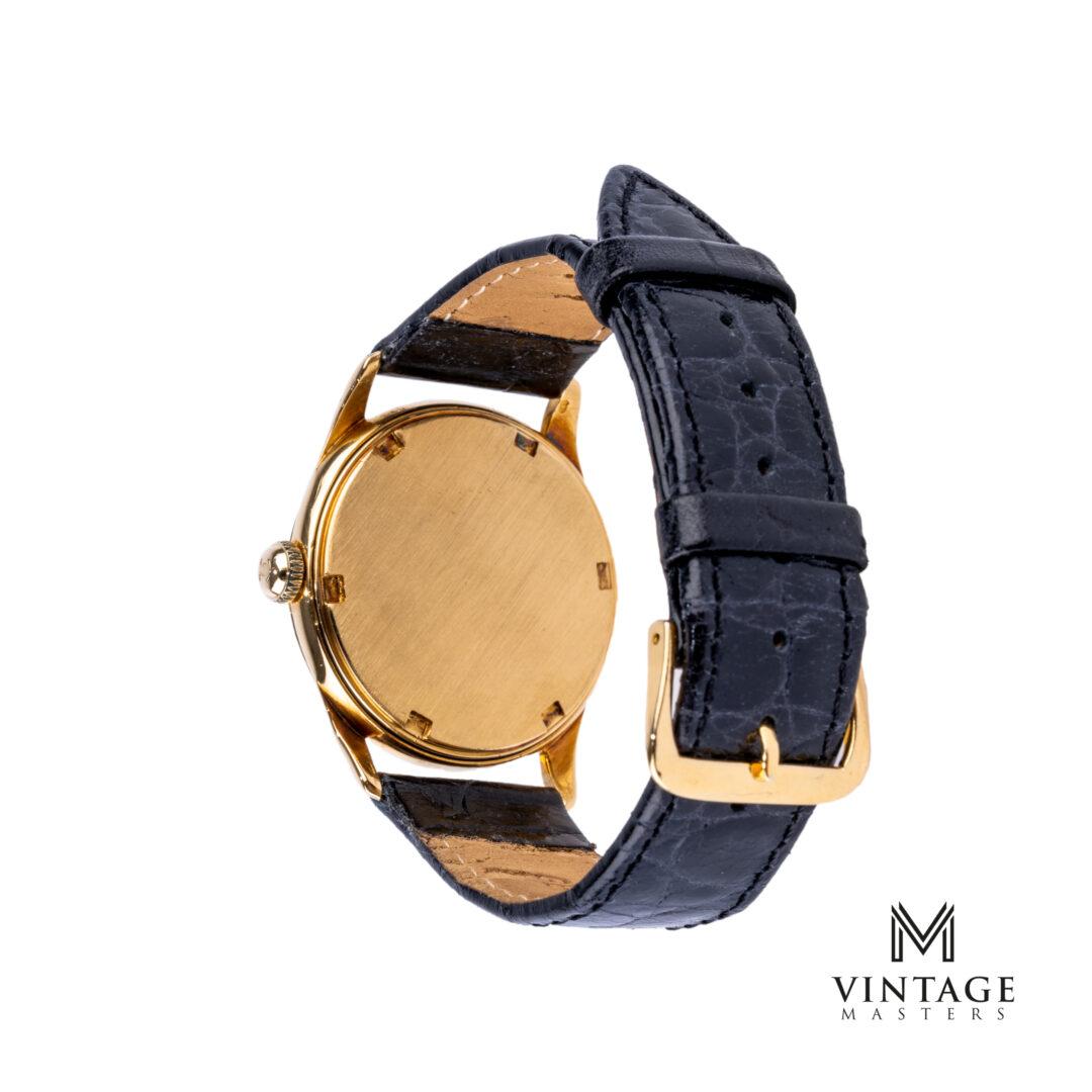vintage Omega 18k gold 2690 honeycomb dial watch caseback