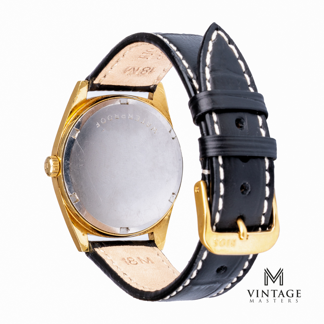 vintage Omega Geneve black dial gold plated back