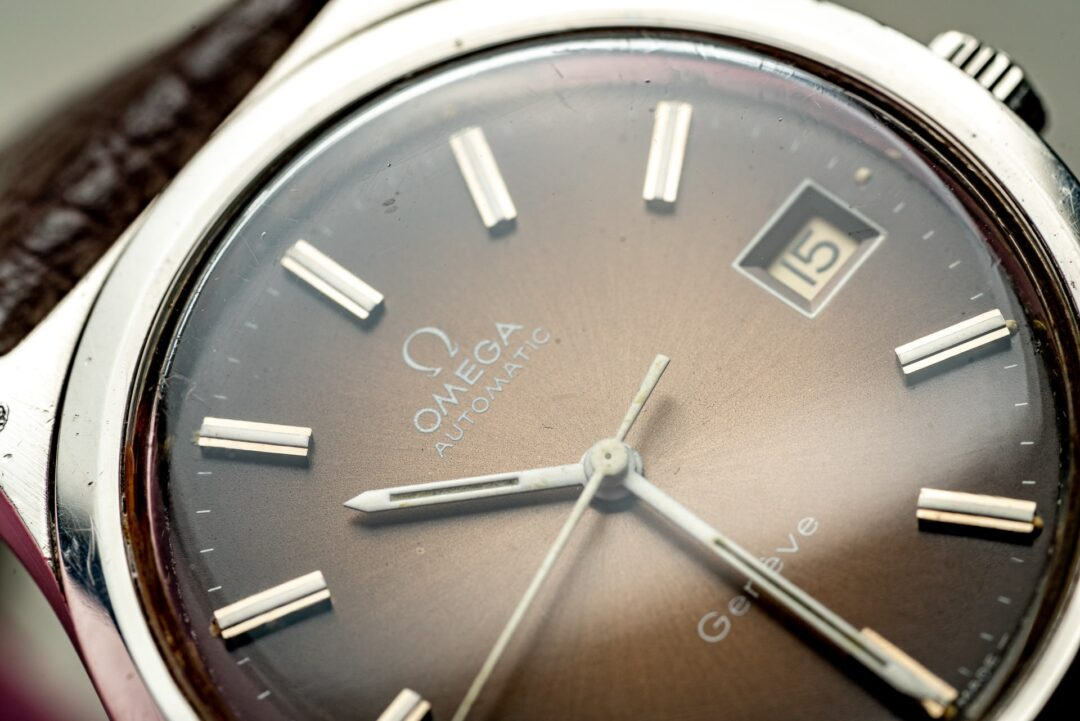 vintage omega geneve 166.0168 bronze dial watch 1974 macro of dial
